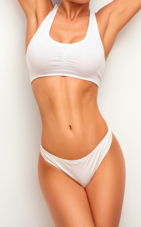 A woman in and white top and underwear with a nice body aesthetic, prime example of what coolsculpting can achieve